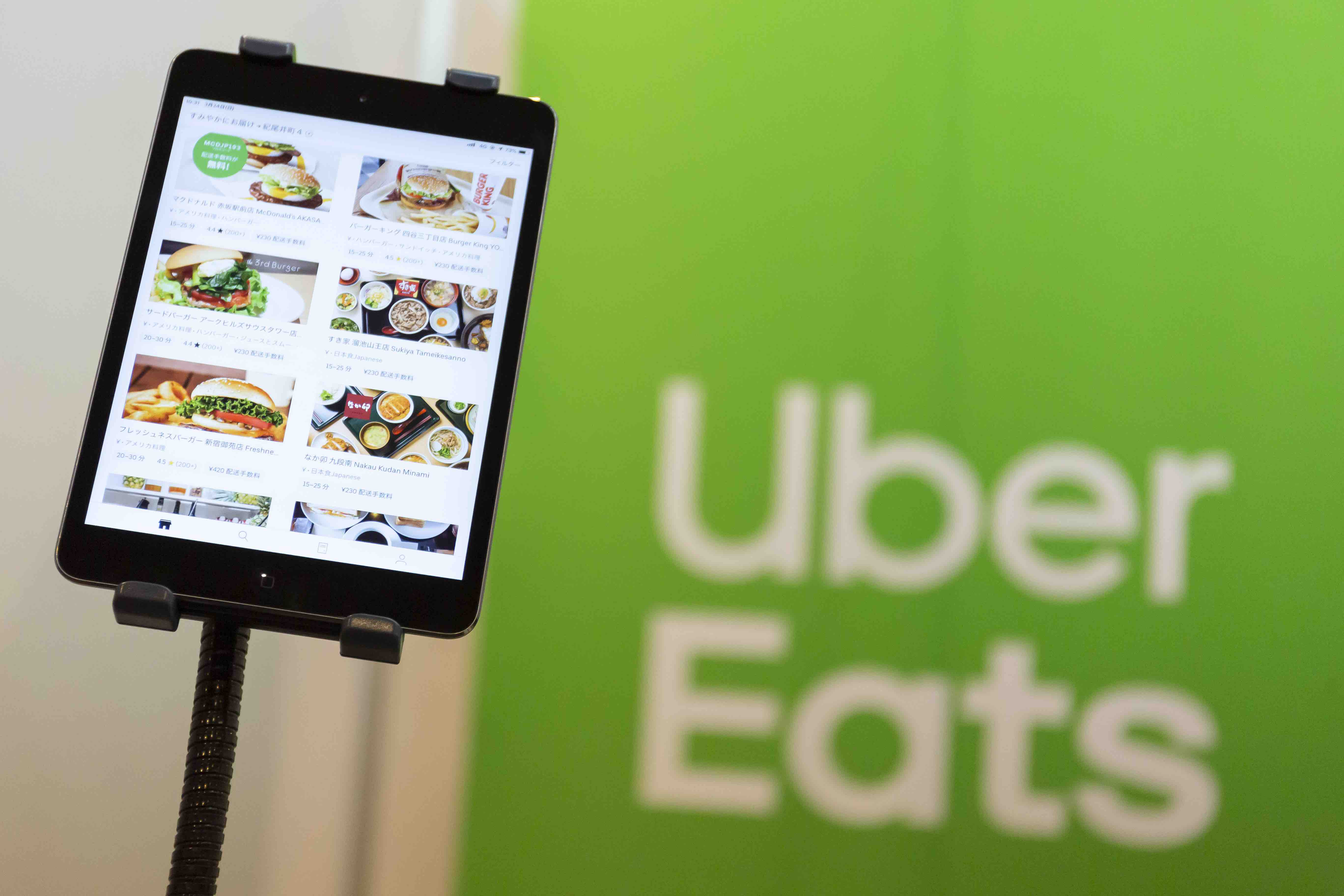 uber eats rideshare app on ipad for ordering food delivery